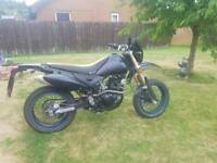 Adrenaline Pulse 125cc supermoto with aftermarket t4 exhaust