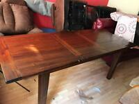 Solid oak stained dark extending dining table