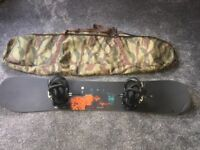 Burton snowboard with bindings and travel bag