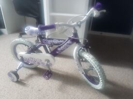 Girls eclipse bike with stabilers would suit age 3+. From smoke free home