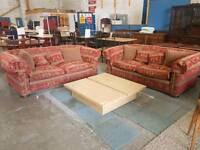 Red patterned fabric three and two seater sofa suite with scatter cushions