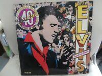 Elvis Presley pink vinyl LP and Beach Boys EP