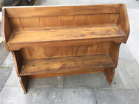 Small pine bookcase with plank solid back with 2 shelves In good condition Size L 34in D 8in H 30in.