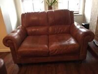 Two seater brown leather settee