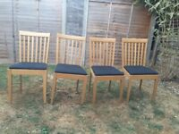 Ikea solid oak dining table and four chairs