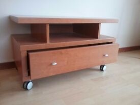 Solid wood TV stand in very good condition.