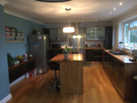 Fitted Kitchen Units- Gloss black and solid oak
