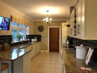 Kitchen, numerous cabinets, integrated BOSCH double oven and 10m granite