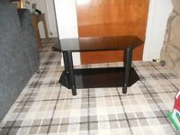 Black TV stand 70cmL X 35WcmX40 H good condition could deliver locally