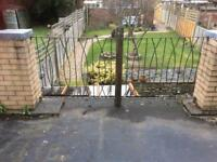Iron railings and brick posts with lead covers