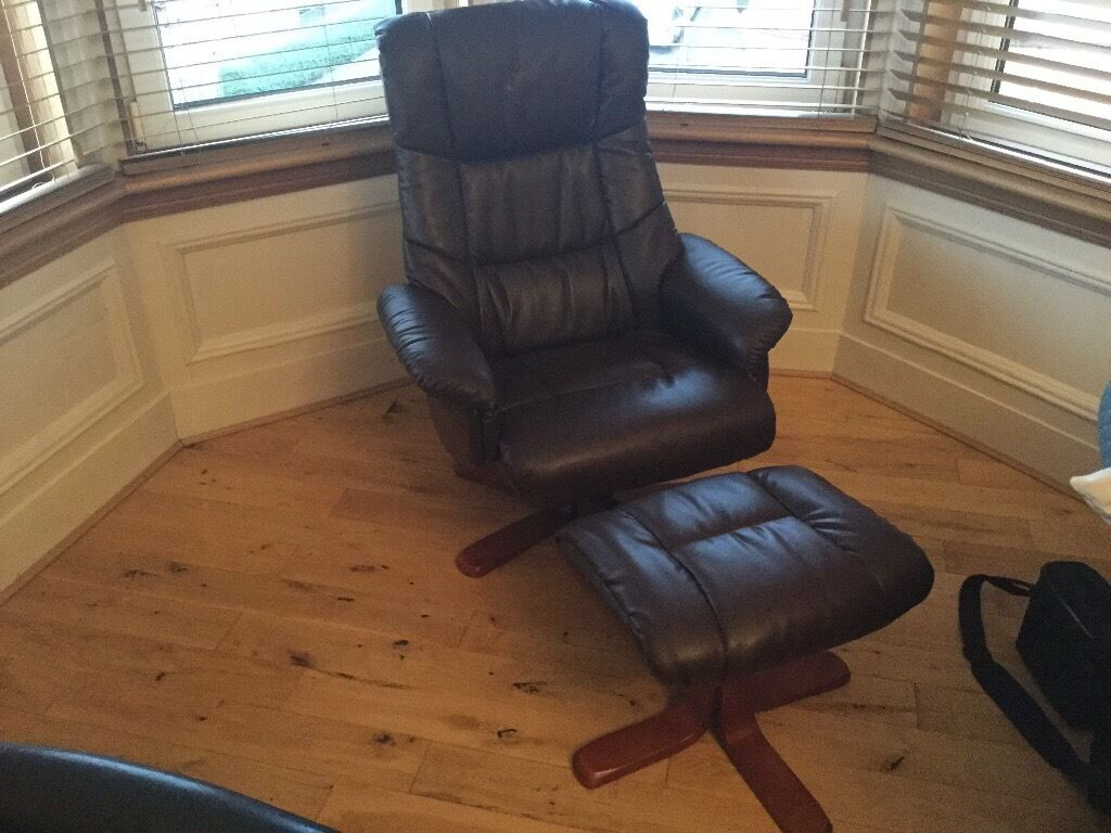 Brown recliner chair with foot stool
