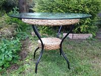 Glass topped rattan outdoor table