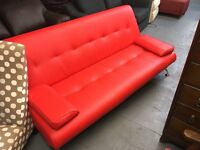 RED FAUX LEATHER CLICK CLACK SOFA BED