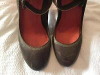 Brown and red high heeled shoes
