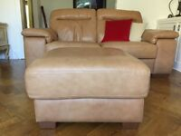 2x leather sofas + matching leather footstool