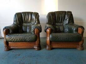2 GREEN LEATHER OAK FRAMED ARMCHAIRS ON SOLID WOODEN FRAMES QUALITY CHAIRS DELIVERY AVAILABLE