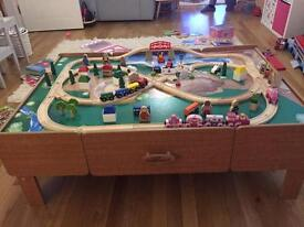 Train table with 34 piece Brio train set
