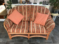 Brown wicker 2 seater sofa, two tilt swivel chairs and foot stool all matching set