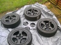 SET 4,STUNNING,GENUINE FORD,14 INCH,4 STUD,4 X 108 PCD,CENTRES,AND 185/55/14 TYRES