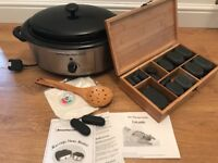 43 piece not stone massage set with heater and accessories.