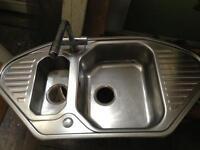 Kitchen sink with mixer tap
