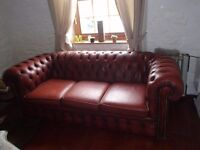 2 Ox Blood Red leather Chesterfield sofas