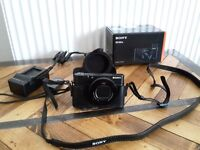 Sony RX100 IV Camera plus case and spare batteries as new condition rx 100