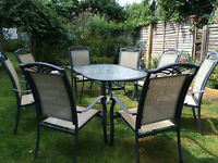 Garden glass top table with 8 chairs