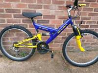 "Boys 24"" wheel full suspension mountain bike."