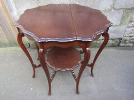 Antique octagonal two tier mahogany table