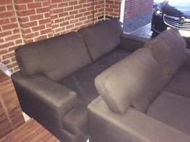 3 & 2 seater dark brown material sofa.