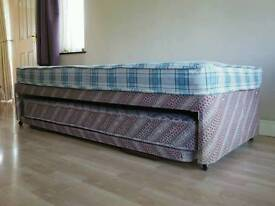 Single bed with guest bed.