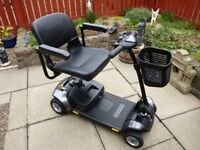 Pride Mobility Go-Go Elite Traveller easily transportable mobility scooter. Excellent condition.