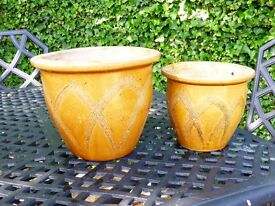Two glazed matching decorative planters