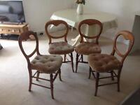 Four wooden antique balloon back chairs beige covering