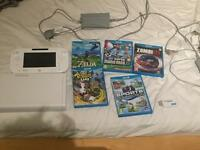 Wii u 8gb console with 5 games inc. legend of Zelda breath of the wild