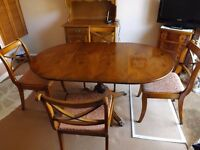 Drop Leaf Oval Walnut dining table and four chairs