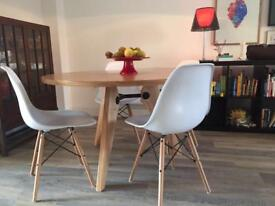 Round dinning table and Eames style chairs