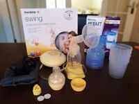 Medela Swing Electric Breast Pump with free accessories and storage cups