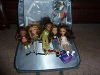 5 Bratz dolls and accessories and carry case