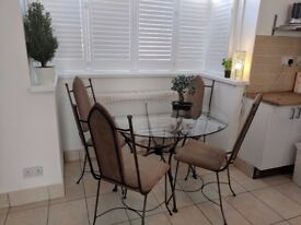 glass dining table and 4 very comfortable padded chairs.