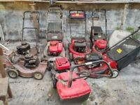 7 OLD NON WORKING LAWN MOWERS. plus chain saw, strimmers