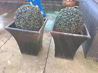 Garden pots and plastic topiary balls