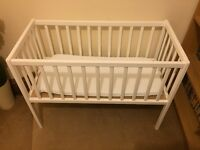 White cot 40cm by 90cm with mattress.