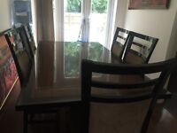 Dining table set with 5 solid chairs . Pick up ASAP