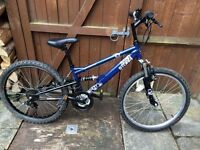 Boys blue Apollo Sandstorm mountain bike. 20inch wheels.