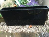 4 black metal troughs