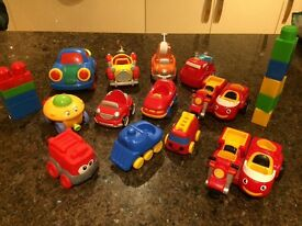 12 x play toy cars and a few plastic bricks