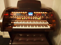 Lowrey Sensation Organ with Stool & many music books. Immaculate condition.