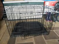 Dog's crate (medium) in black. Includes, base tray and cushion. Very good condition
